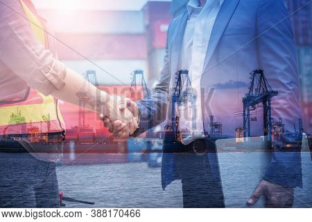 Double Exposure Of Businessman And Container Shipping Worker Greeting Handshake Together With Contai