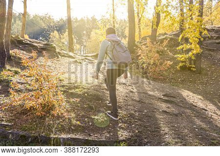 Hiking Concept. Hipster Young Woman With Hiking Backpack Goes Walks Among The Hills,  Back View. Cli