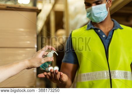 Cropped Engineer Worker Using Alcohol Based Hand Sanitizer Gel For Washing Hand While Working In Fac
