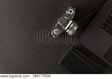 Retro Analog Slr Camera And Notebook Next To Laptop On Black Desk In Office, Digital Photography Or