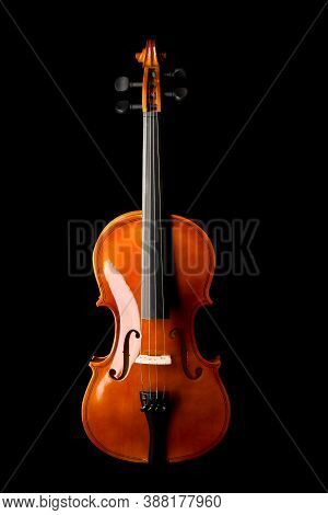 Brown Wooden Fiddle Or Violin, Classic Musical Instrument, Isolated Over Black Background, Flat Lay