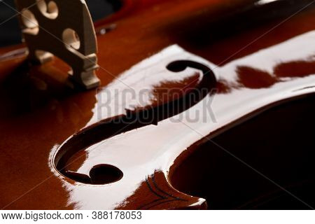 Close Up Macro Of F Hole On Brown Wooden Fiddle Or Violin, Classic Musical Instrument, Over Black Ba