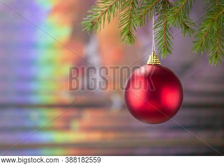 Beautiful Christmas Card With A Red Ball On A Spruce Branch