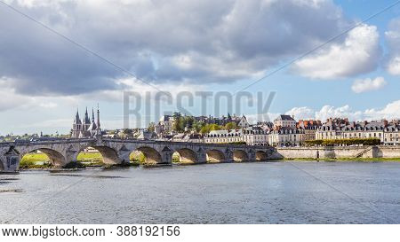 Cityscape Blois In France With Ancient Stone Bridge Jacques-gabriel Over The Loire River And Eglise
