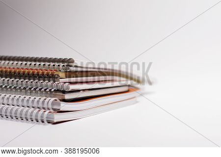 A Pile Of Notebooks With Bound Pages. Side View.