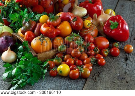 Tomatoes, Peppers, Onions On The Table. Preservation Of The Autumn Harvest Of Vegetables. Glass Jar