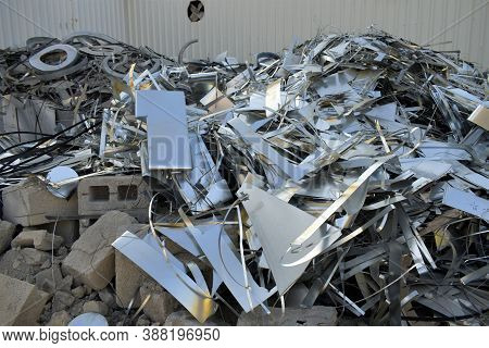 Sheet Metal Wastages At The Outside Of Duct Factory. Galvanized Steel Coil In The Duct Factory. Pack