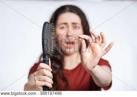 Portrait In A Blur, A Screaming Brunette Woman Holds A Comb In Front Of Her, Clearing It From A Pile