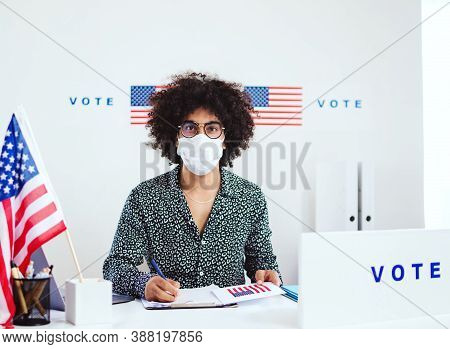Mixed-race Member Of Electoral Commission In Polling Place, Usa Elections And Coronavirus.