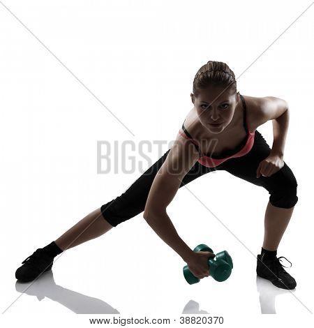 Sport junge athletische Frau Ausfallschritte mit Kurzhanteln, Kontur-Studioaufnahme over white background