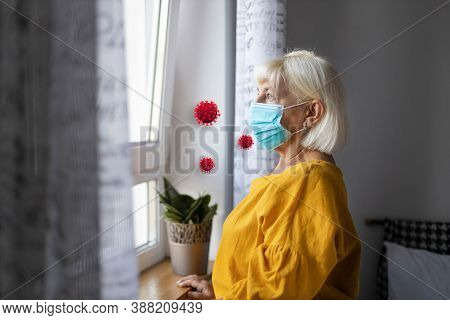 Sick Woman In A Medical Protective Mask And Home Clothing Near Window In Isolation At Home For Virus