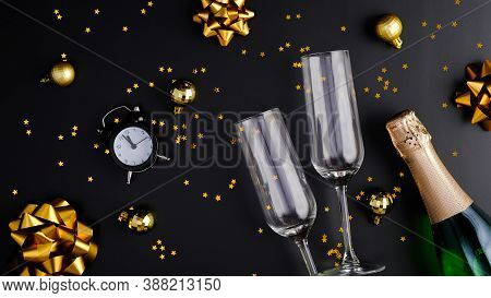 New Year Eve Party Celebration Concept. Flat Lay Composition With Two Glasses, Champagne Bottle, Gli