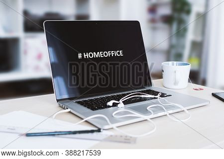 Homeoffice With Notebook, Headphones And A Cup Of Tea In A Living Room
