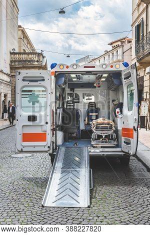 Ambulance Van Rescue Victims Of Epidemic Coronavirus Interior Covid-19 Emergency. Ambulance And Equi