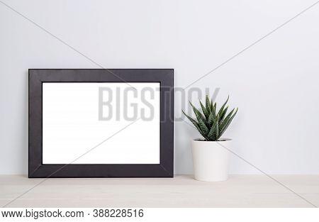 Mockup Frame And Plants In Pot On Table Top At Home, Mock Up Poster For Presentation On Desk, Indoor