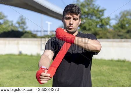 Boxer Preparing For Training With Forearm Bandage Outside