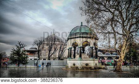 Istanbul, Turkey - January 2013: German Fountain Alman Cesmesi On A Rainy Day In Sultanahmet Square,