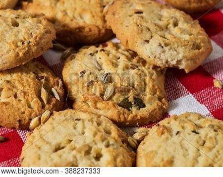Oatmeal cookies is on gingham checkered fabric on table in rustic style. Healthy food breakfast.