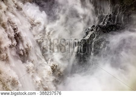Abstract Scene Of Spectacular Dettifoss Waterfall In Iceland After Floods Filled With Muddy Water An