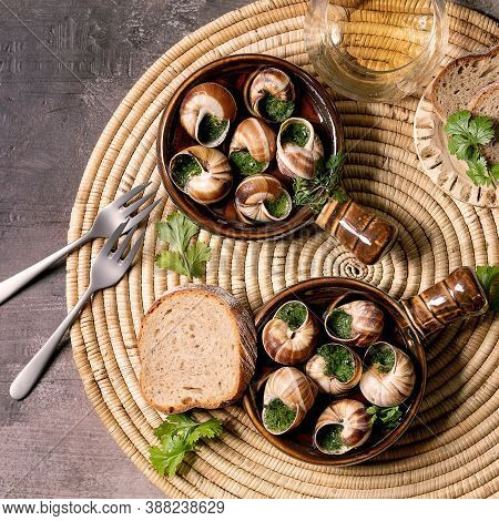 Escargots De Bourgogne - Snails With Herbs Butter, Gourmet Dish, In Traditional Ceramic Pans With Pa