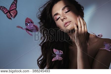 Portrait of a beautiful woman with butterflies