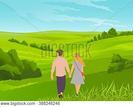 Young Romantic Couple Walks In Park Or Field. Grass In The Foreground, Bushes, Thickets, Valley. Wal