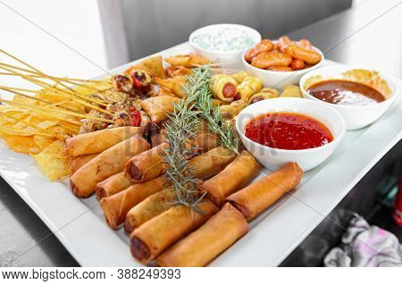 Spring Rolls And Dip On A White Plate At Corporate Gala Event