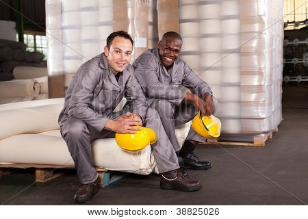 two textile factory workers relaxing during break