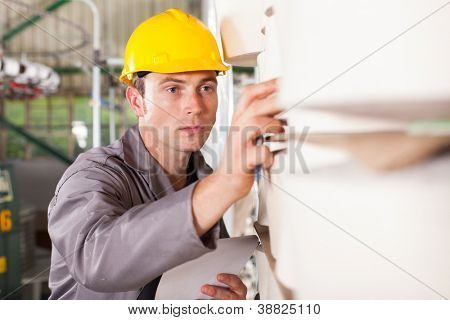 textile industrial worker checking raw material poster