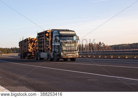 Bobruisk, Belarus 26.06.2019: A Timber Truck Carries Logs From The Forest On The Highway Against A B
