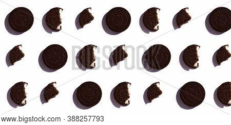 Round Chocolate Cookie Pattern On A White Isolated Background. A Banner With The Cookies Whole And B