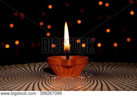 Happy Diwali. Selective Focus Of Clay Diya Lamps Lit During Diwali Festival. Hindu Festival Of Light