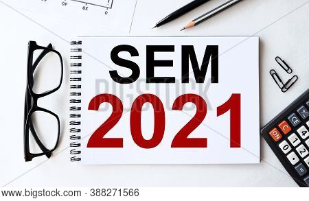 Sem 2021. Text On White Paper On White Background Near Calculator