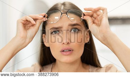What, Doubt Concept. Closeup Portrait Of Confused Beautiful Lady With Bad Vision And Poor Eyesight T