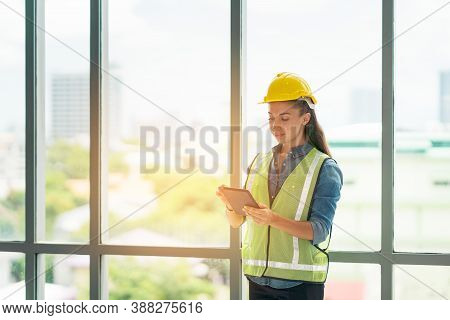 Woman Architect Or Construction Engineer With Digital Tablet Wear Helmet