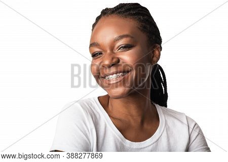 Orthodontics Treatment. African American Woman With Dental Braces Smiling To Camera Posing Over Whit