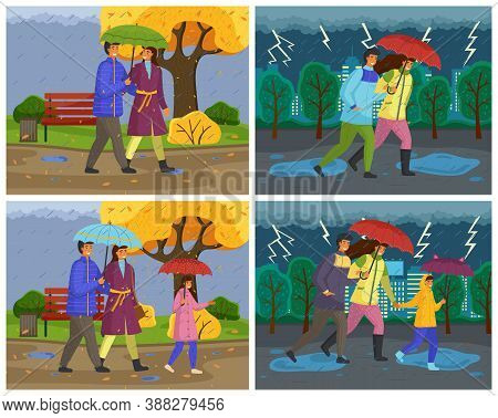 Family Walking In The Rain With Umbrella And Wearing Raincoats In Autumn Season. Parents And Daughte