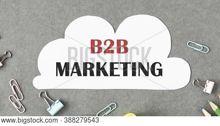 B2b Marketing Is On The Business Card. Nearby Is A Pen, Reports And Books.