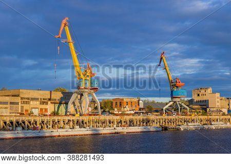 Port cranes on sunset - industry background