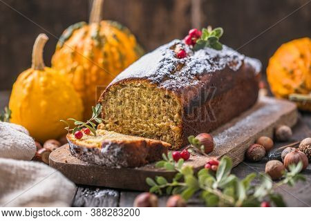 Delicious Pumpkin Cake On Cutting Board. Loaf Of  Bread With Pumpkins.homemade Autumn Butternut Squa