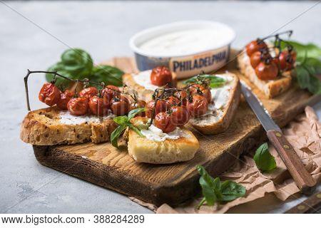 Kiev, Ukraine - September  26 2020: Philadelphia Snacks With Bruschetta, Roasted Tomatoes. Delicious