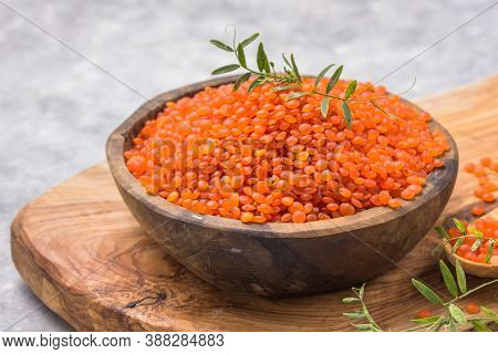 Uncooked Red Lentil Legumes, Herbaceous Plant (lens Culinaris) In Bowl. Red Lentils In Wooden Spoon