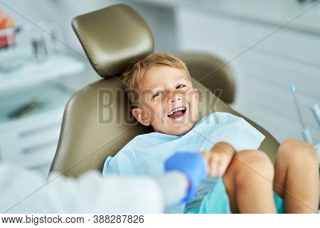 Little boy and female dentist in the dentists office