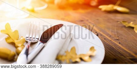 Art Thanksgiving Dinner Background With Holidays Plate And Flatware On Table