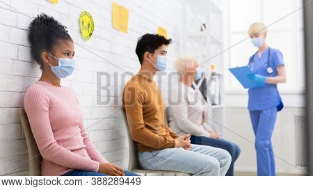 Coronavirus Vaccination Concept. Black Girl Waiting For Covid-19 Vaccine Sitting In Queue With Diver