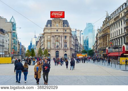 Brussels, Belgium - October 05, 2019: People Walking By Central Street Of Brussels, Belgium.