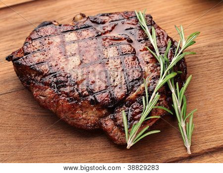 Beef steak on a wooden table.