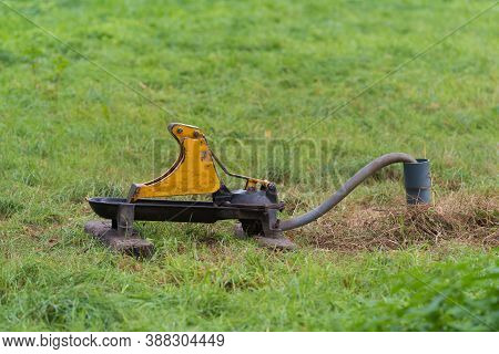 Metal Drinking Water Pump In A Meadow For Animals