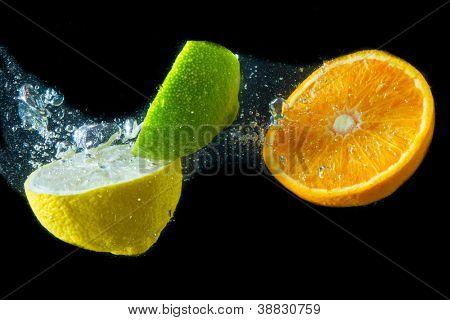 fruit splashing in the water