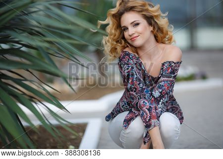 Young Beautiful Blonde Caucasian Woman Walking Summer Streets. Beautiful Girl, Urban Portrait.young